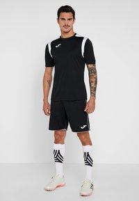 Joma - CHAMPION - T-shirt imprimé - black/white - 1