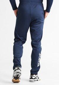 Joma - NILO - Pantalon de survêtement - navy - 2