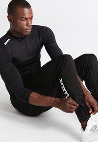 Joma - NILO - Jogginghose - black - 3