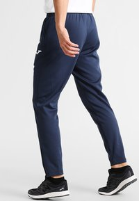 Joma - ELBA - Pantalon de survêtement - navy - 2
