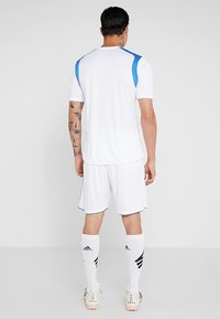 Joma - LIGA - Korte sportsbukser - white/royal - 2
