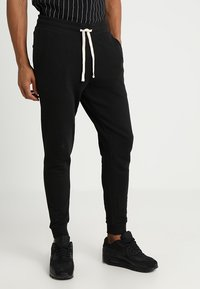 Jack & Jones - JEHOLMEN   - Verryttelyhousut - black - 0