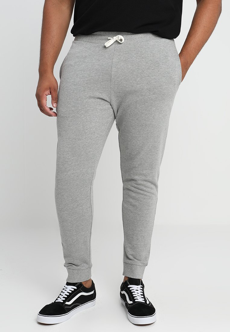 Jack & Jones - JJEHOLMEN PANTS PLUS - Tracksuit bottoms - light grey melange