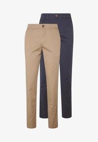 beige/navy blazer