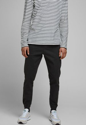 JOGGINGHOSE ANTI FIT - Tracksuit bottoms - black