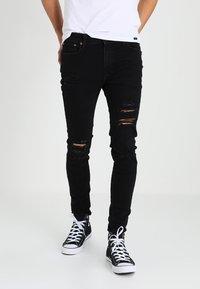 Jack & Jones - JJILIAM JJORIGINAL - Jeans Skinny - black denim - 0