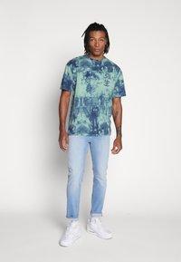 Jack & Jones - TIM ORIGINAL - Jeans slim fit - blue denim - 1