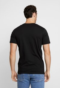 Jack & Jones - JORMELTING TEE CREW NECK  - T-shirt print - black - 2