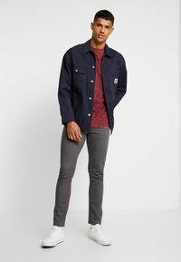 Jack & Jones - JORSPACEY TEE CREW NECK - Camiseta estampada - brick red - 1
