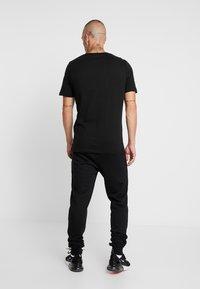 Jack & Jones - JCOSEGA PLAYSTATION TEE CREW NECK - T-shirt med print - black - 3