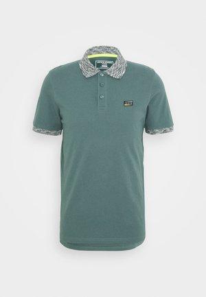 JCOMOOSE - Polo - green