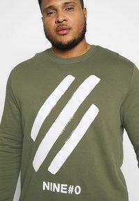 Jack & Jones - JCOHOLM CREW NECK - Sweatshirt - dusty olive - 3