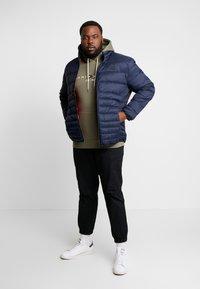 Jack & Jones - JJEBOMB PUFFER COLLAR - Winter jacket - navy blazer - 1