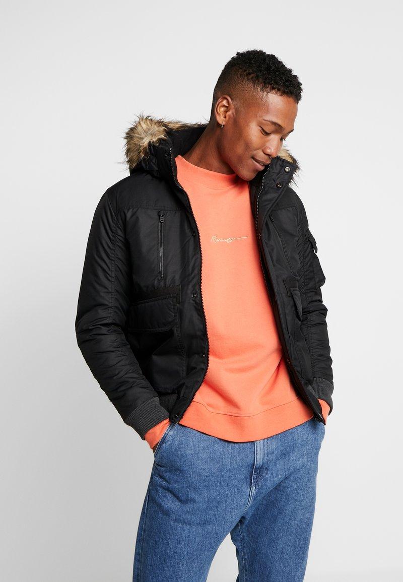 Jack & Jones - JCOGLOBE BOMBER - Winter jacket - black