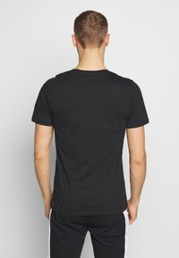 Jack & Jones - Print T-shirt - black - 0