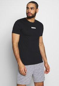 Jack & Jones Performance - JCOZSS TEE SLIM FIT 2 PACK - Basic T-shirt - white/black - 3