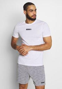 Jack & Jones Performance - JCOZSS TEE SLIM FIT 2 PACK - Basic T-shirt - white/black - 1