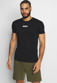 Jack & Jones - JCOZSS TEE - Basic T-shirt - black - 0