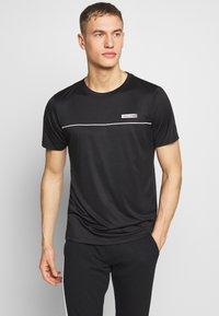 Jack & Jones Performance - JCOZSS PERFORMANCE TEE - Print T-shirt - black - 0