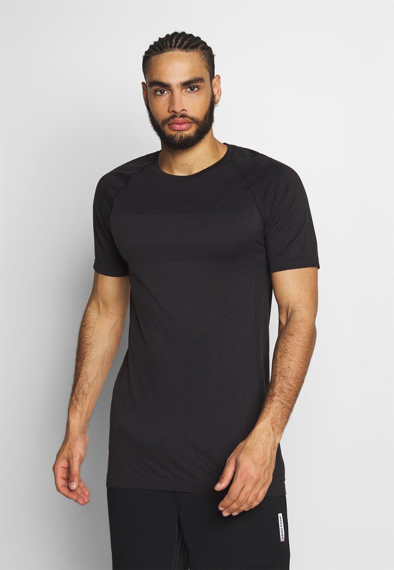 Jack & Jones Performance - JCOZSS SEAMLESS TEE - Basic T-shirt - black