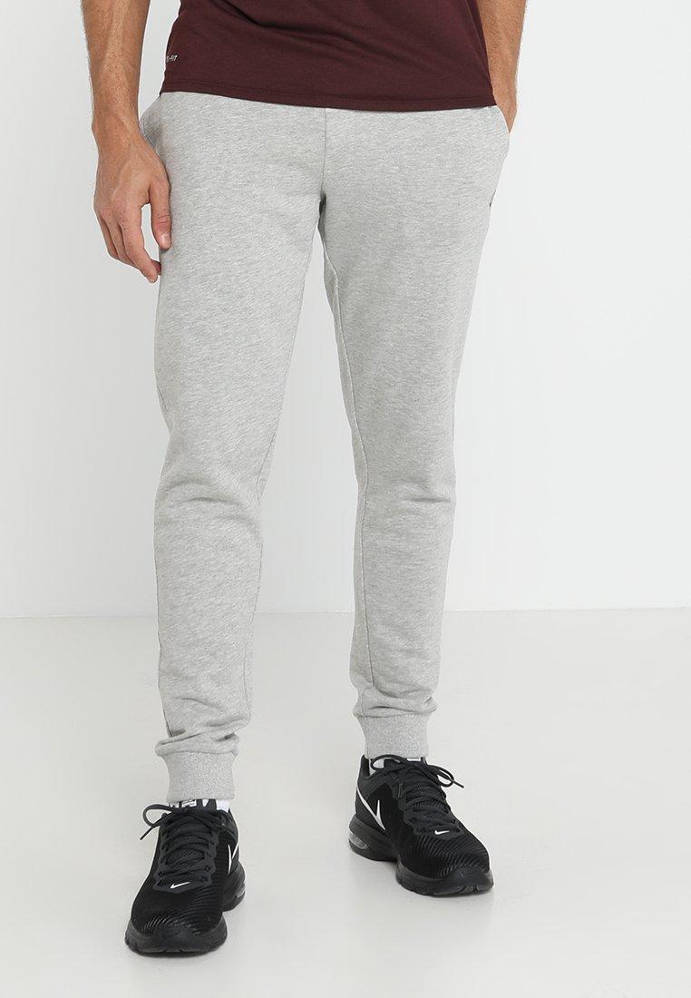 Jack & Jones - Pantalones deportivos - light grey melange