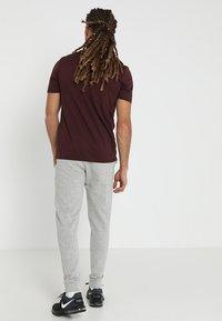 Jack & Jones - Pantalones deportivos - light grey melange - 2