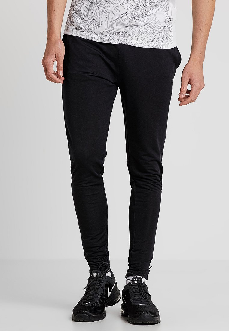 Jack & Jones - JCOKICKER PANTS - Verryttelyhousut - black