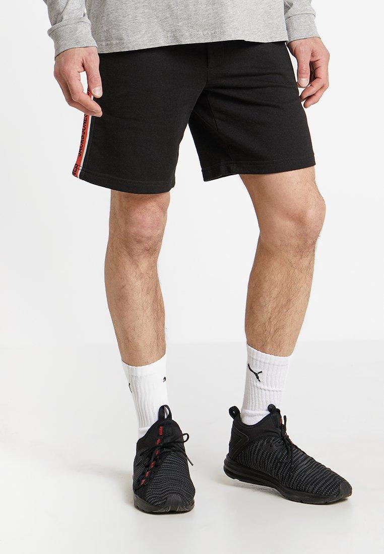Jack & Jones - JJIVISION SHORTS MID - Sports shorts - black