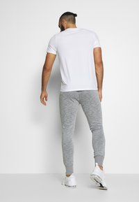 Jack & Jones - JJWILL PANTS - Tracksuit bottoms - light grey melange - 2