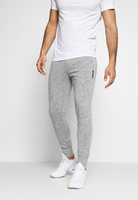 Jack & Jones - JJWILL PANTS - Tracksuit bottoms - light grey melange - 0
