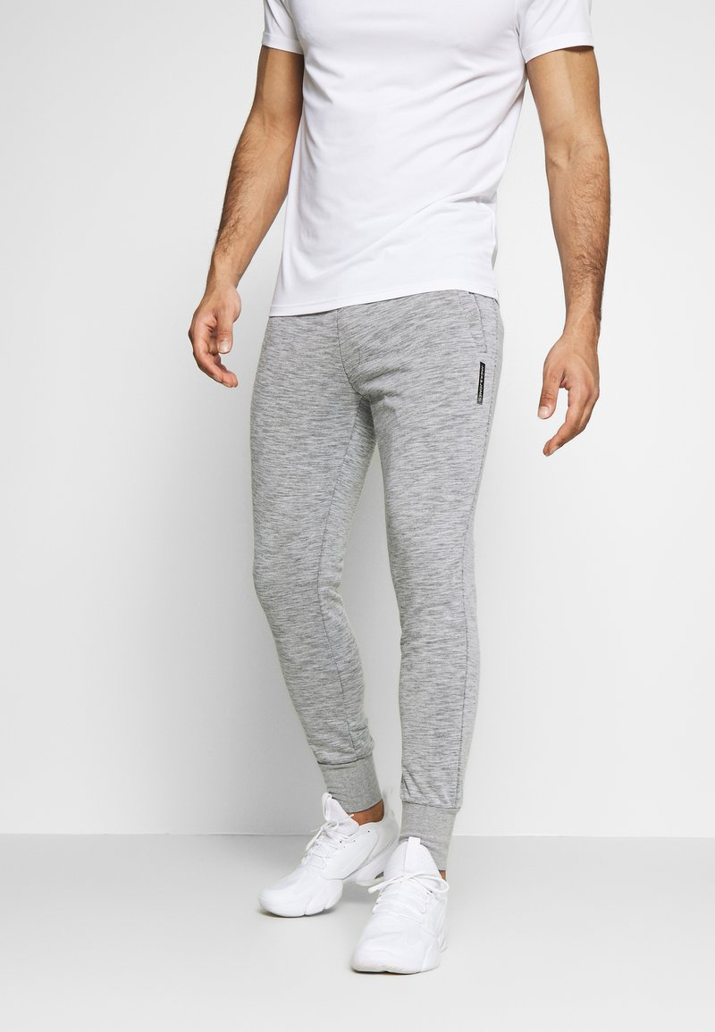 Jack & Jones - JJWILL PANTS - Tracksuit bottoms - light grey melange