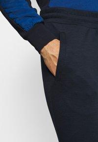 Jack & Jones Performance - JJWILL JJZSWEAT PANTS - Tracksuit bottoms - sky captain - 3