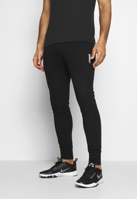 Jack & Jones Performance - JJWILL JJZSWEAT PANTS - Tracksuit bottoms - black - 0