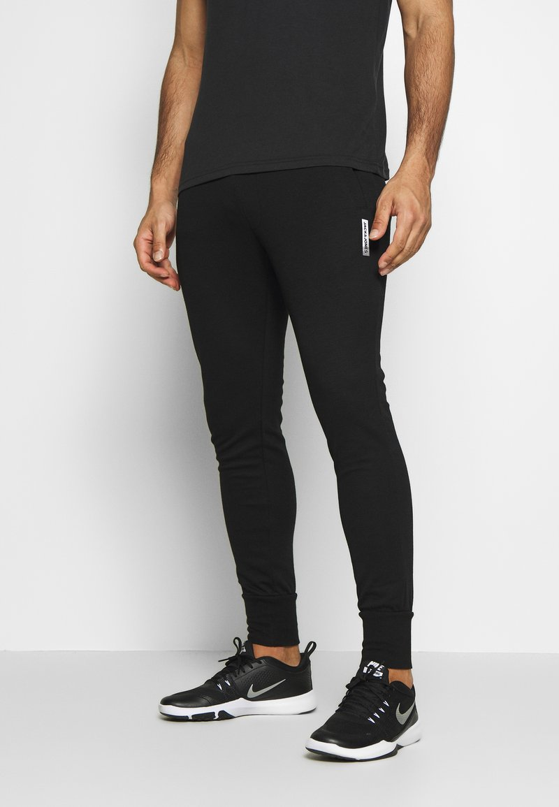 Jack & Jones Performance - JJWILL JJZSWEAT PANTS - Tracksuit bottoms - black