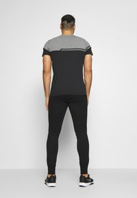 Jack & Jones Performance - JJWILL JJZSWEAT PANTS - Tracksuit bottoms - black - 2