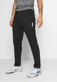 Jack & Jones - JJIWILL PANT - Teplákové kalhoty - black - 0