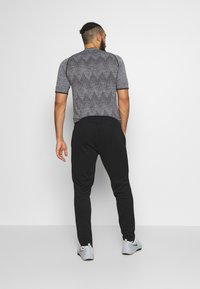 Jack & Jones Performance - JJIWILL PANT - Pantalones deportivos - black
