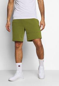 Jack & Jones Performance - JJIZPOLYESTER SHORT - Sports shorts - winter moss - 0