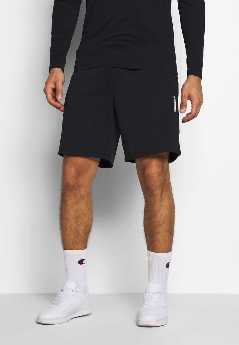 Jack & Jones Performance - JJIZPOLYESTER SHORT - Sports shorts - black