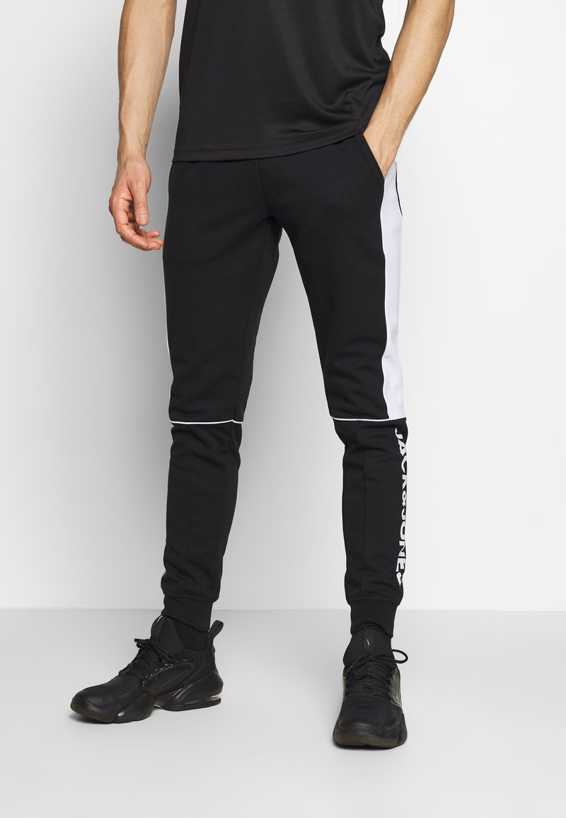 Jack & Jones - JJIWILL JJSABER PANTS  - Tracksuit bottoms - black