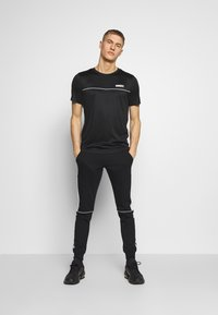 Jack & Jones - JJIWILL JJSABER PANTS  - Tracksuit bottoms - black - 1