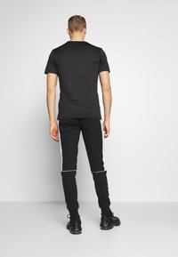 Jack & Jones - JJIWILL JJSABER PANTS  - Tracksuit bottoms - black - 2