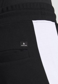 Jack & Jones - JJIWILL JJSABER PANTS  - Tracksuit bottoms - black - 5
