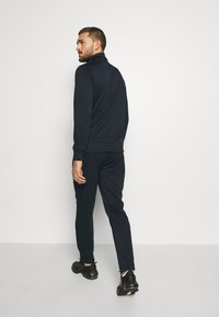 Jack & Jones Performance - JCOZPOLY SUIT - Tracksuit - sky captain - 4