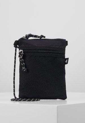 JACRIBSTOP SLINGBAG - Taška spříčným popruhem - black