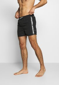 Jack & Jones - IARUBA TAPE - Shorts da mare - black - 1
