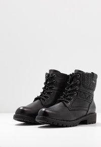 Jana - Kotníková obuv - black - 4