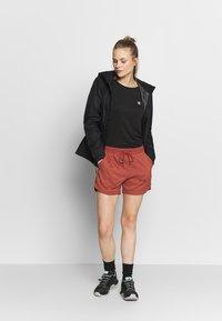 Jack Wolfskin - SENEGAL SHORTS - Sports shorts - auburn - 1