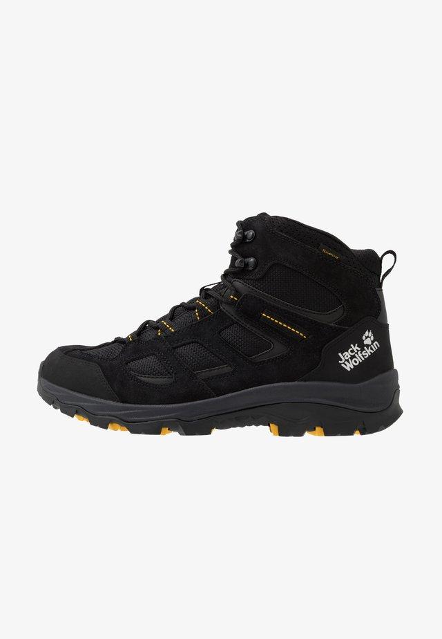 VOJO 3 TEXAPORE MID - Hiking shoes - black/burly yellow