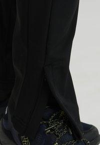 Jack Wolfskin - ZENON SOFTSHELL PANTS - Outdoor trousers - black - 5